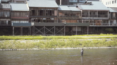 A man fishing on the river in Kyoto Janpan Stock Footage