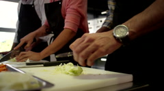 Chefs cutting vegetable at kitchen. Stock Footage