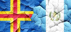 aland islands with Guatemala flag on a grunge cracked wall - stock illustration