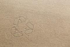 Cardboard with recycling symbol Stock Photos