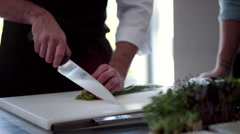 Chefs cutting vegetable in kitchen. Stock Footage
