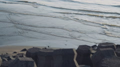 Stone tetrapod blocks on the beach Stock Footage