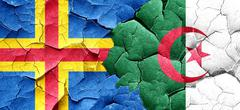 Aland islands with Algeria flag on a grunge cracked wall Stock Illustration