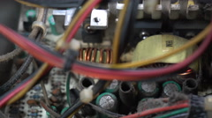 Dolly shot of old electronic circuit board. Closeup Stock Footage