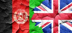 Afghanistan flag with Great Britain flag on a grunge cracked wal - stock illustration