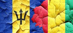 Barbados flag with Guinea flag on a grunge cracked wall - stock illustration