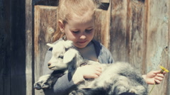 Girl with baby goat. RAW video record Stock Footage