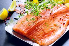 Raw salmon fillets Stock Photos