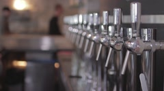 Draft Beer Taps And People In The Background, Slow Motion - stock footage