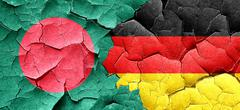 Bangladesh flag with Germany flag on a grunge cracked wall - stock illustration