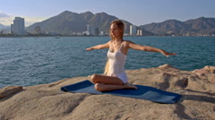 Blond Girl in Top Sits in Lotus Yoga Pose Hands behind Back Stock Footage