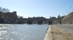 River rome italy old stone bridge contrustion Tiberius Bridge Tevere River 4k Stock Footage