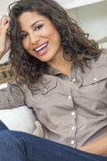 Hispanic Woman Laughing With Perfect Teeth Stock Photos
