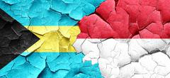 Bahamas flag with Indonesia flag on a grunge cracked wall Stock Illustration