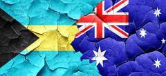 Bahamas flag with Australia flag on a grunge cracked wall Stock Illustration