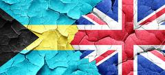Bahamas flag with Great Britain flag on a grunge cracked wall Stock Illustration