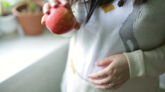Ripe red apple in the hands of a young girl Stock Footage