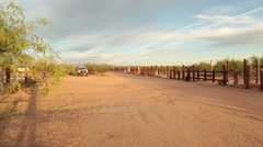 Right pan of a fenced pasture in the Desert Stock Footage