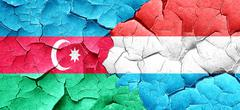 Azerbaijan flag with Luxembourg flag on a grunge cracked wall - stock illustration
