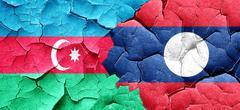 Azerbaijan flag with Laos flag on a grunge cracked wall - stock illustration