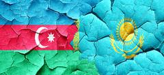 Azerbaijan flag with Kazakhstan flag on a grunge cracked wall Stock Illustration
