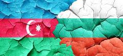 Azerbaijan flag with Bulgaria flag on a grunge cracked wall Stock Illustration