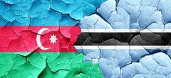 Azerbaijan flag with Botswana flag on a grunge cracked wall Stock Illustration