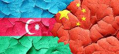 Azerbaijan flag with China flag on a grunge cracked wall Stock Illustration