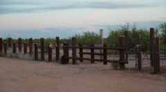 Right pan of a fence for a pasture in the desert - stock footage