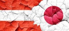 Austria flag with Japan flag on a grunge cracked wall - stock illustration