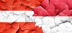 Austria flag with Indonesia flag on a grunge cracked wall Stock Illustration