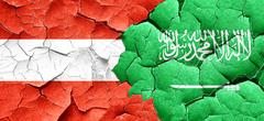 Austria flag with Saudi Arabia flag on a grunge cracked wall Stock Illustration