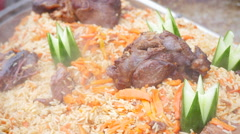 Asian pilaf.Rice with meat Stock Footage