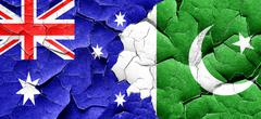 Australia flag with Pakistan flag on a grunge cracked wall Stock Illustration