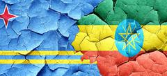 Aruba flag with Ethiopia flag on a grunge cracked wall Stock Illustration