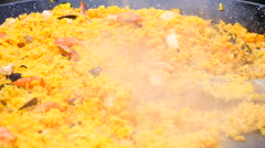 Asian pilaf.Rice with meat - stock footage