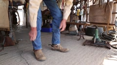 Cowboy putting on his gear Stock Footage