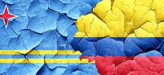 aruba flag with Colombia flag on a grunge cracked wall - stock illustration