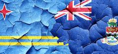 Aruba flag with Cayman islands flag on a grunge cracked wall Stock Illustration
