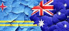 Aruba flag with Australia flag on a grunge cracked wall Stock Illustration
