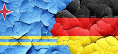 Aruba flag with Germany flag on a grunge cracked wall Stock Illustration