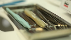 Dentists take the tools out of the case with gloved hands Stock Footage