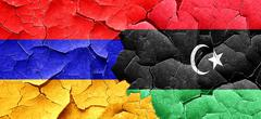 Armenia flag with Libya flag on a grunge cracked wall Stock Illustration