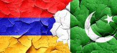 Armenia flag with Pakistan flag on a grunge cracked wall Stock Illustration