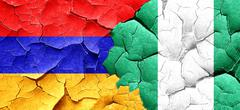 Armenia flag with Nigeria flag on a grunge cracked wall Stock Illustration