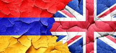 Armenia flag with Great Britain flag on a grunge cracked wall Stock Illustration
