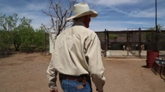 Older man walking over to dog kennels Stock Footage