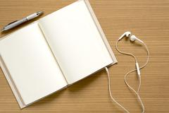Top view of open notebook with earphone Stock Photos