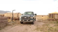 Cowboy pulling in with his truck in the desert Stock Footage