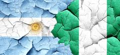 Argentina flag with Nigeria flag on a grunge cracked wall - stock illustration